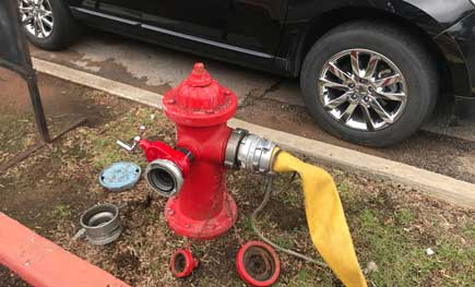 Hose hooked up to a hydrant