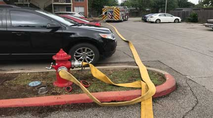 Multiple lines run into a fire hydrant