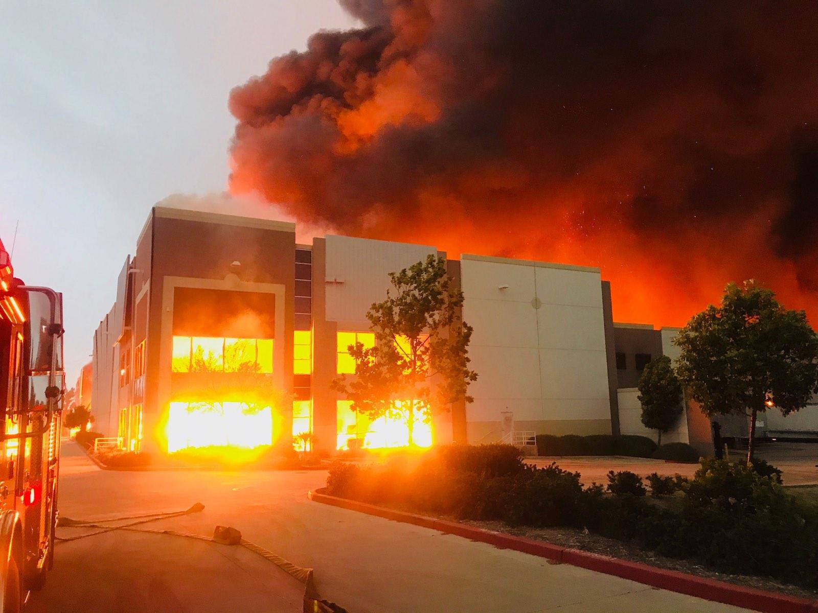 Flames tear through an Amazon distribution center