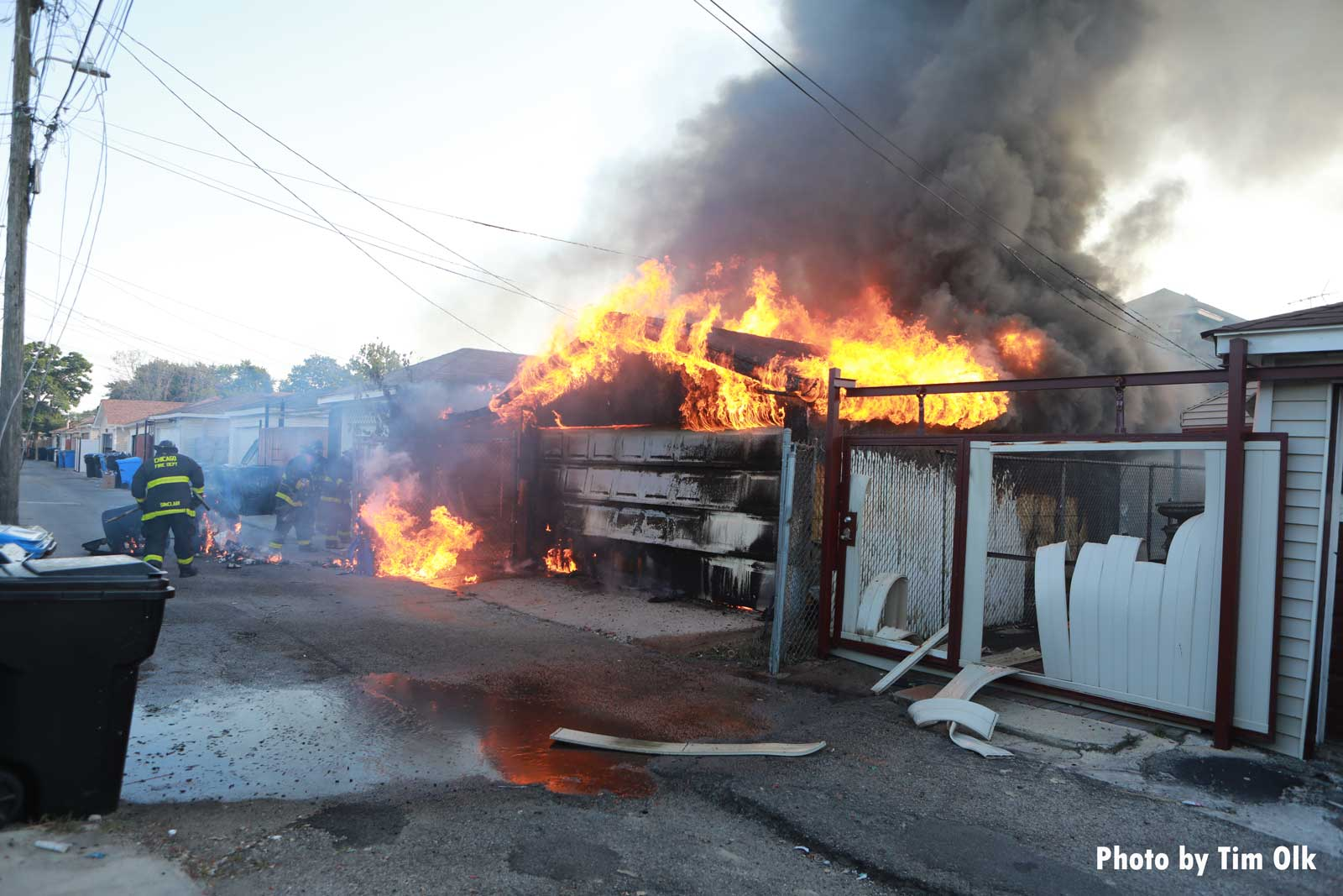 Chicago firefighters battle an alleyway garage fire