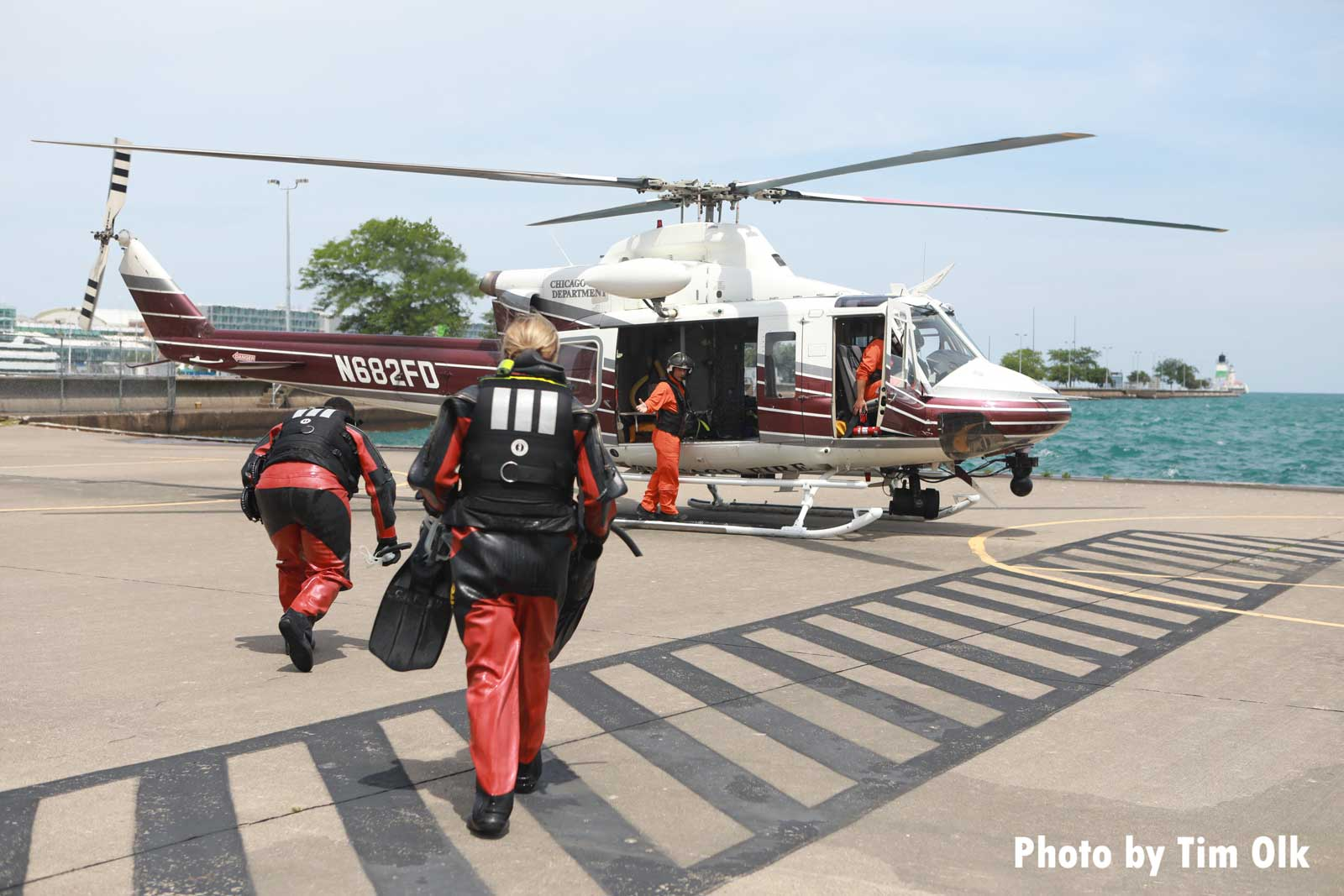 Chicago Fire Department dive team members head to helicopter