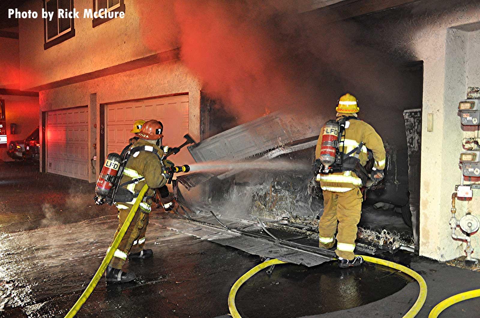 LAFD firefighters begin applying water to garage area