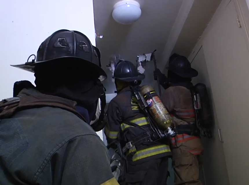 Firefighters performing overhaul