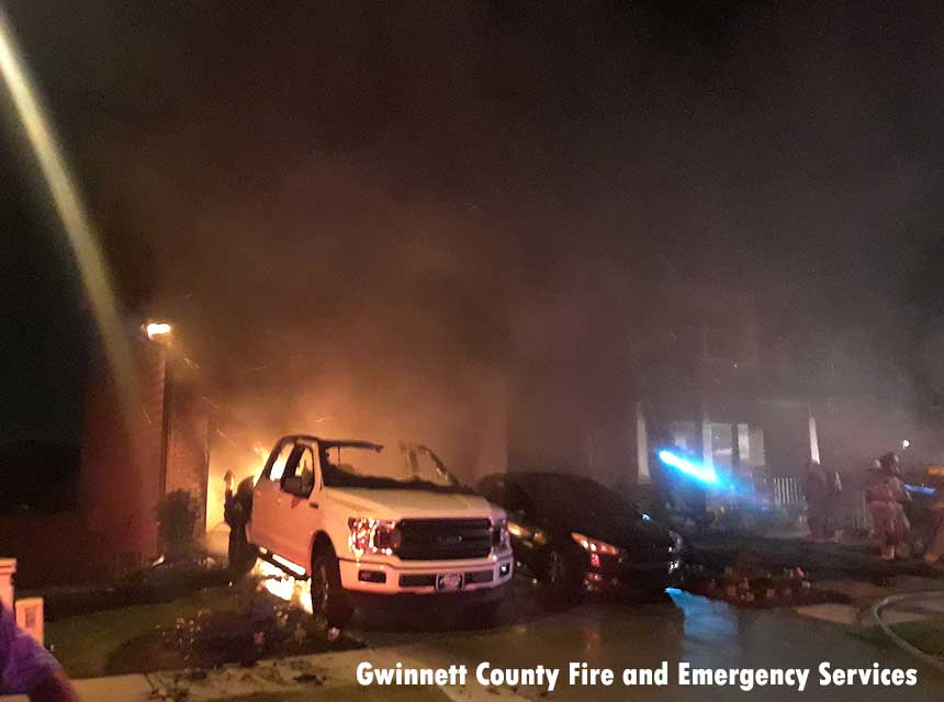 Fire shoots from garage