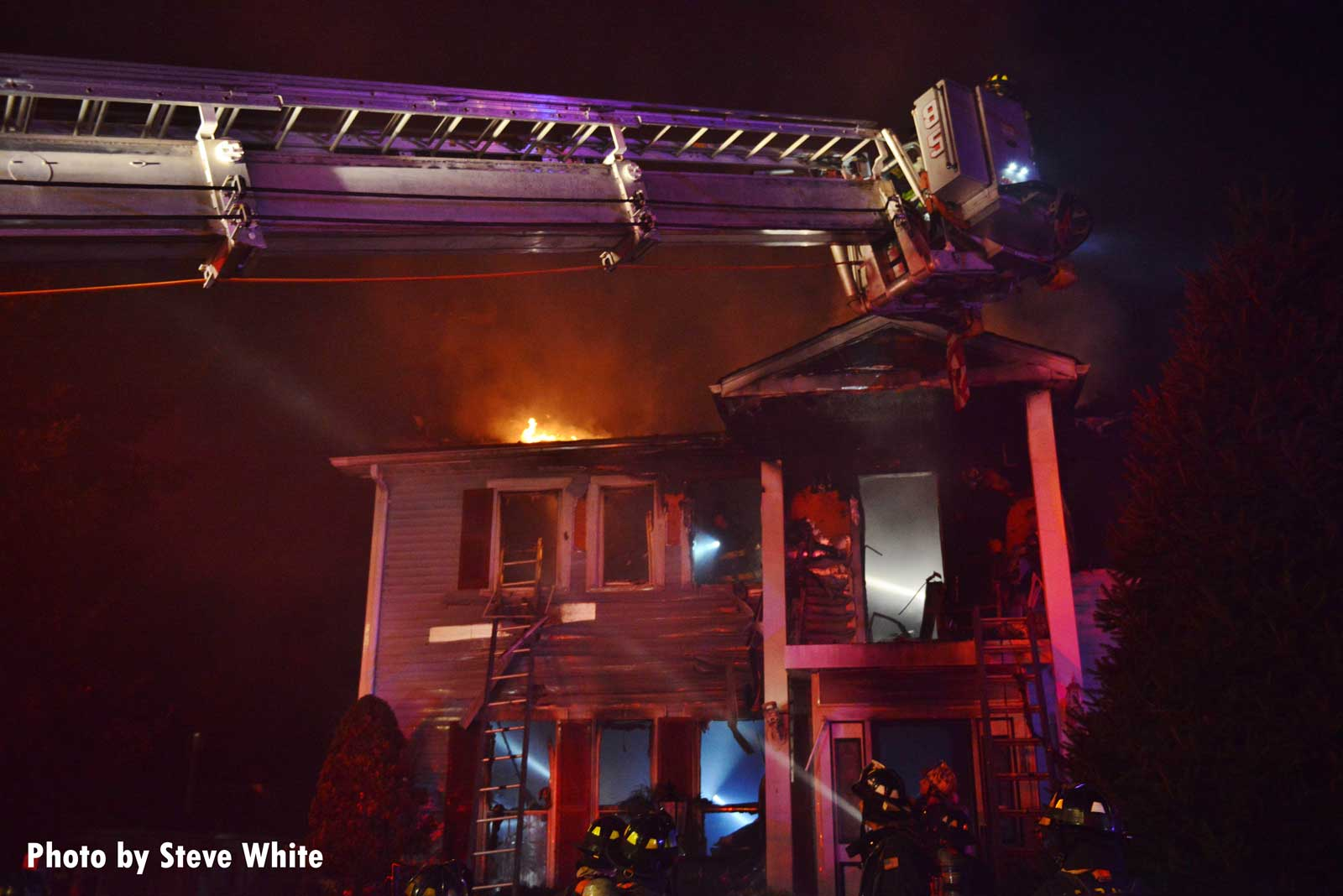 Another shot of house fire with FDNY apparatus and firefighters