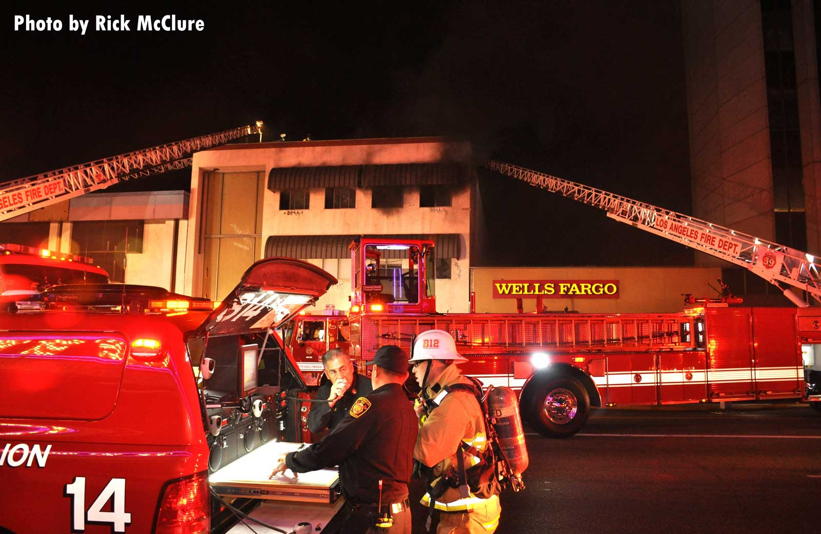 LAFD firefighters and apparatus on scene at large commercial fire