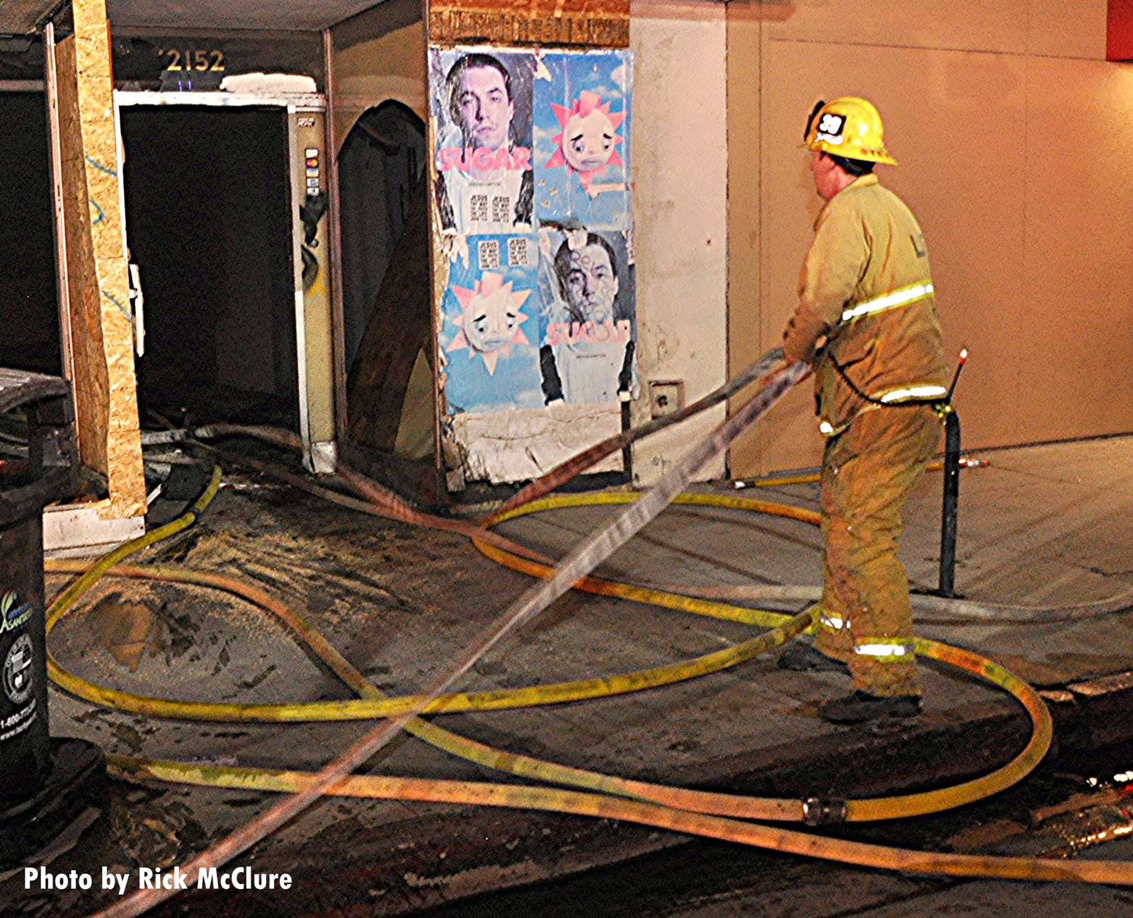 Firefighter pulling a hoseline at the scene