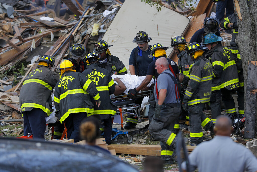 Baltimore City Fire Department carries a person rescued from blast