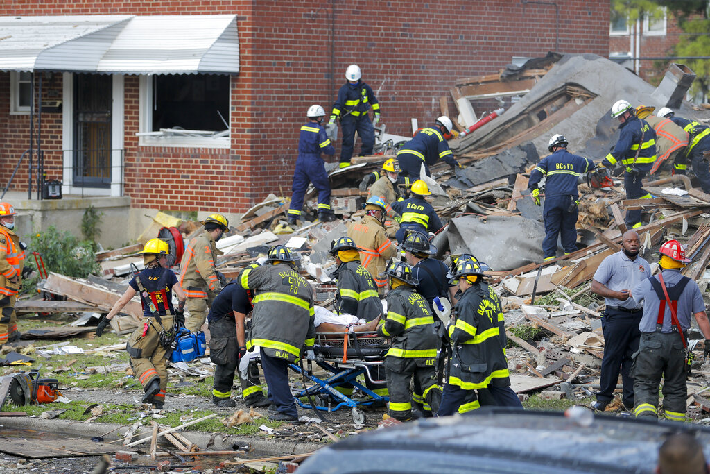 Baltimore City Fire Department carries a person out f