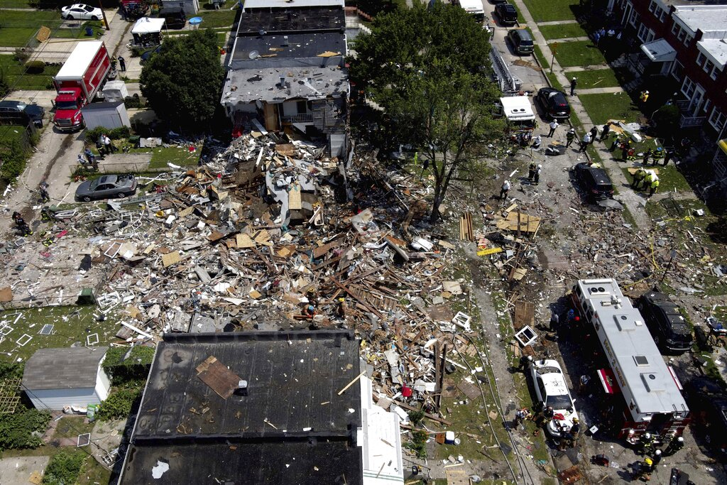 Debris and rubble covers the ground