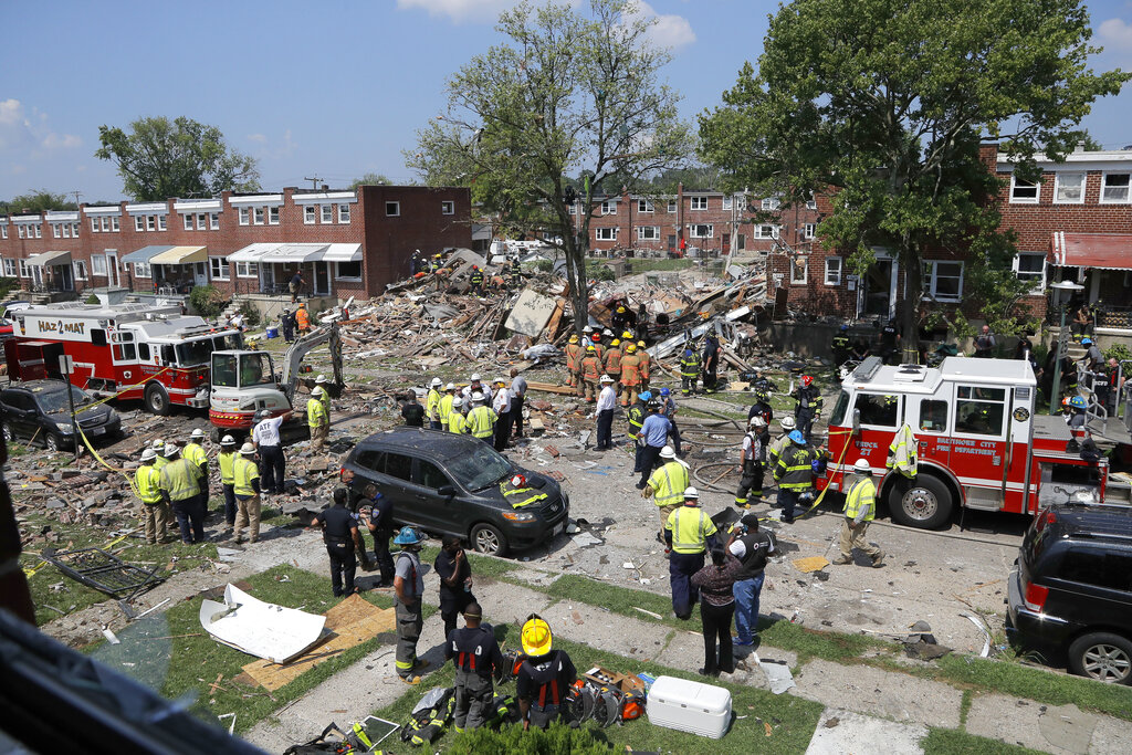 Rescue officials work near the rubble