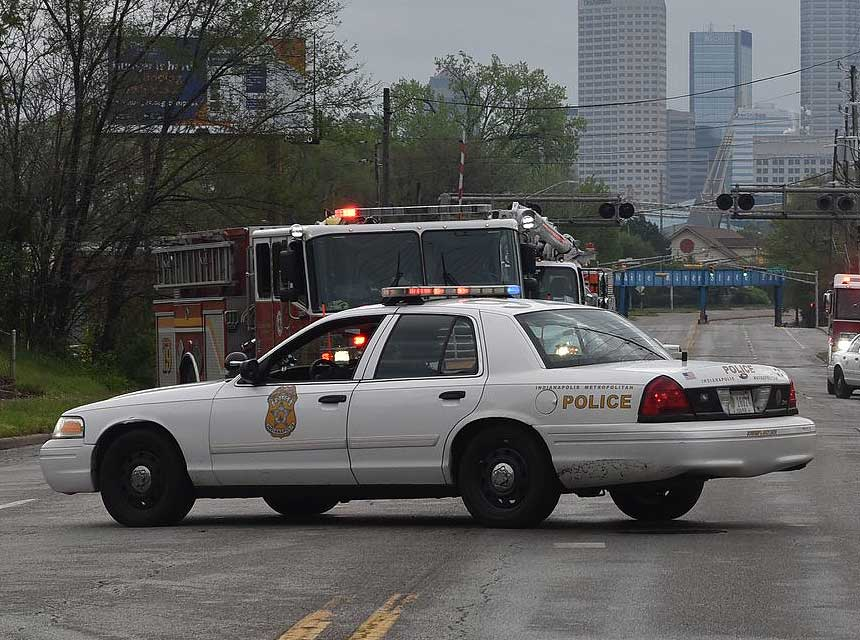 Police car with fire apparatus behind it
