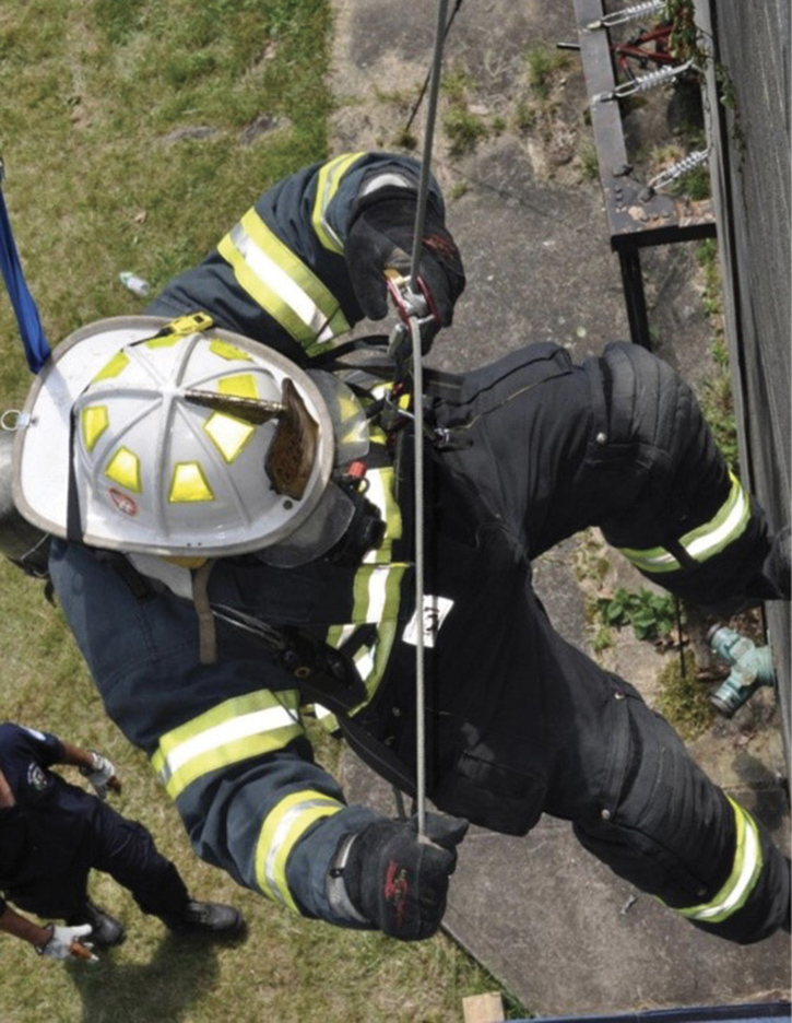 The firefighter descends with the personal escape system.