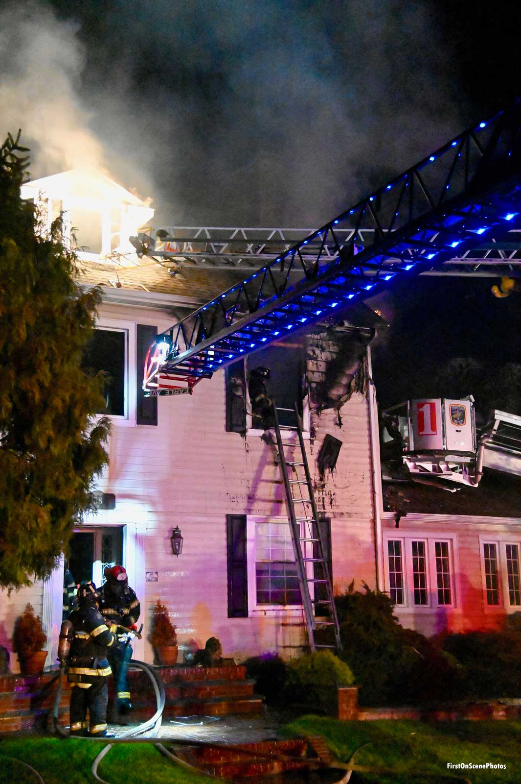Aerial device in use at structure fire