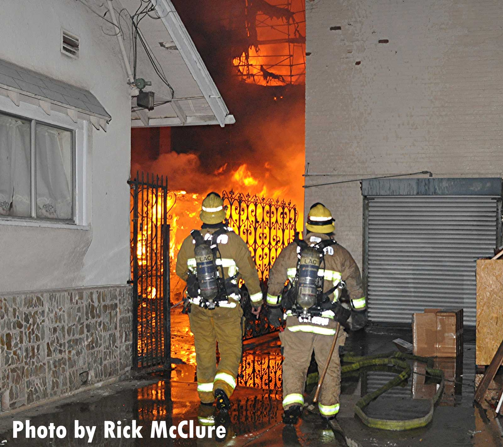 Firefighters see flames raging between the walls