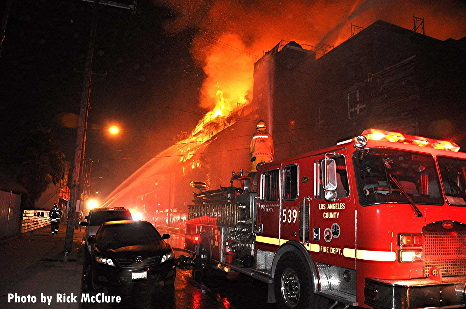 Firefighters working at the huge fire