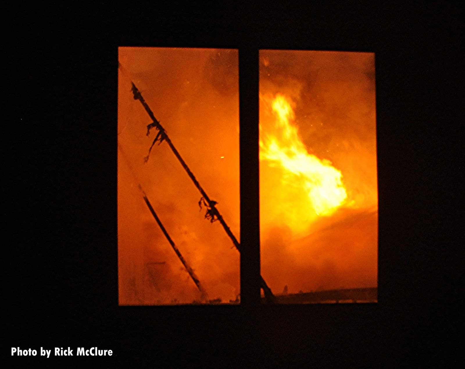 Flames roar at the fire scene