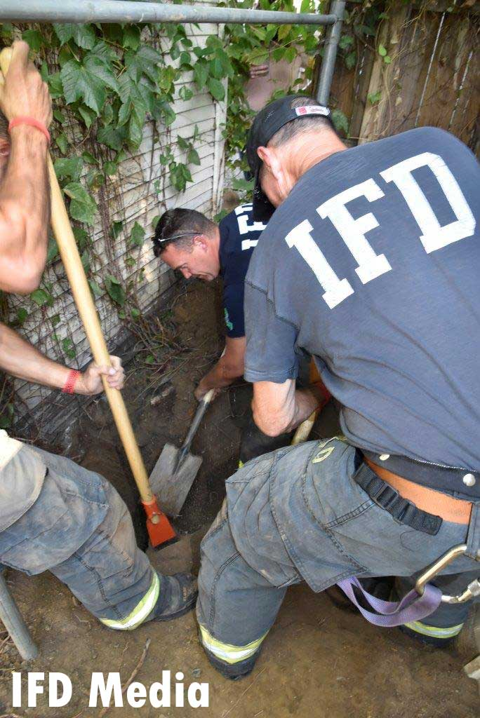 Indy firefighters dig for dog