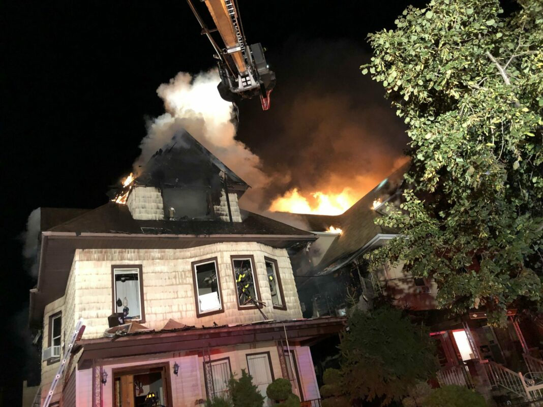 FDNY firefighters operating at a multiple-alarm fire in Brooklyn