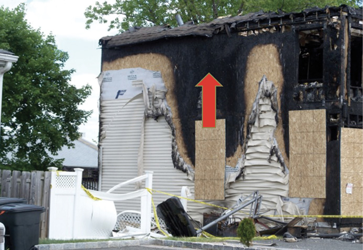 Rapid fire on the exterior of this structure resulted in the collapse and burning off of the roof.