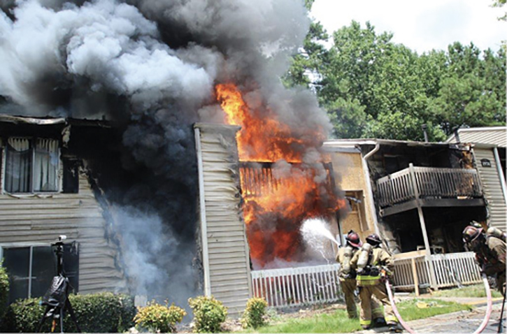 An initial exterior offensive attack with a solid or straight stream is versatile because it can attack exterior and interior fire effectively to rapidly gain fire control and improve conditions before crews advance to the interior.
