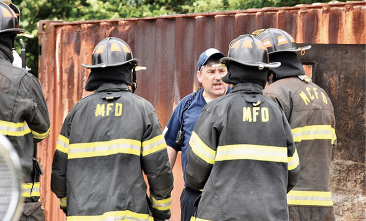 Fire instructor talking to firefighters