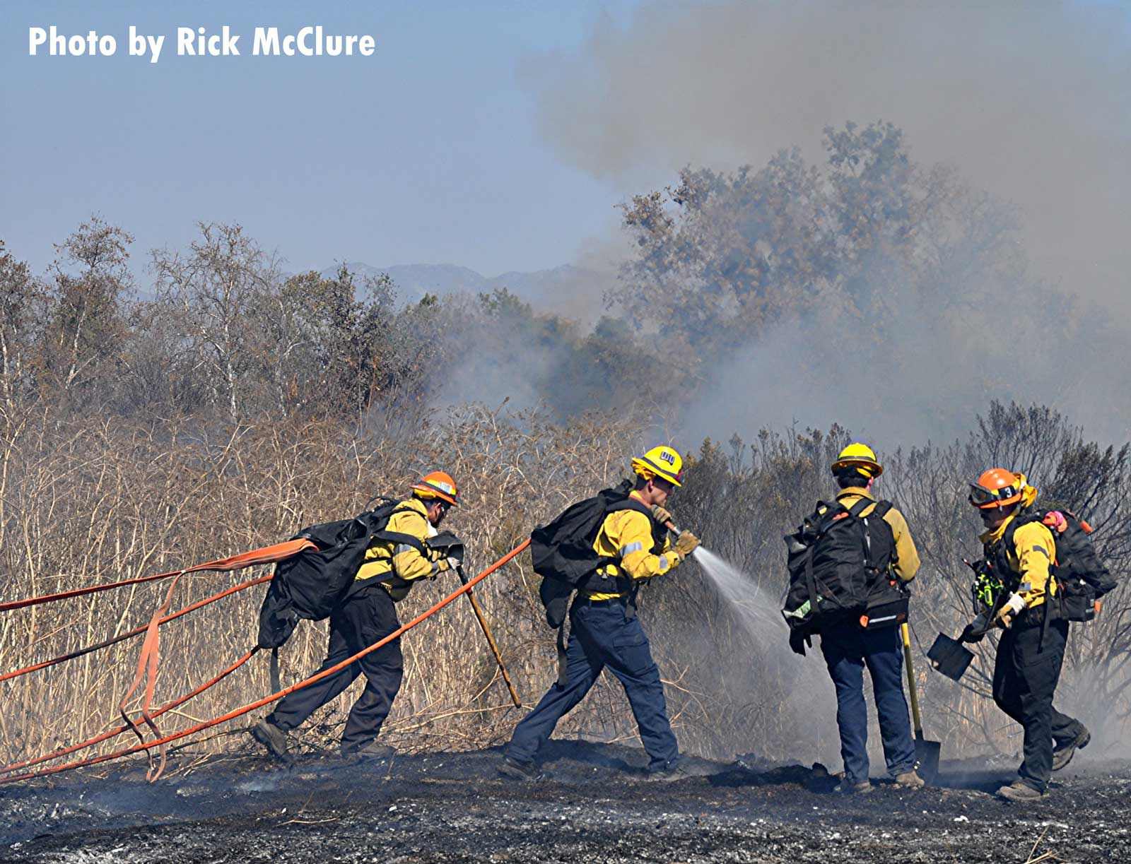 LAFD firefighters pulling hoselines