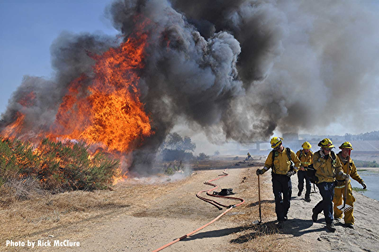 City of Los Angeles firefighters working at a raging vegetation fire