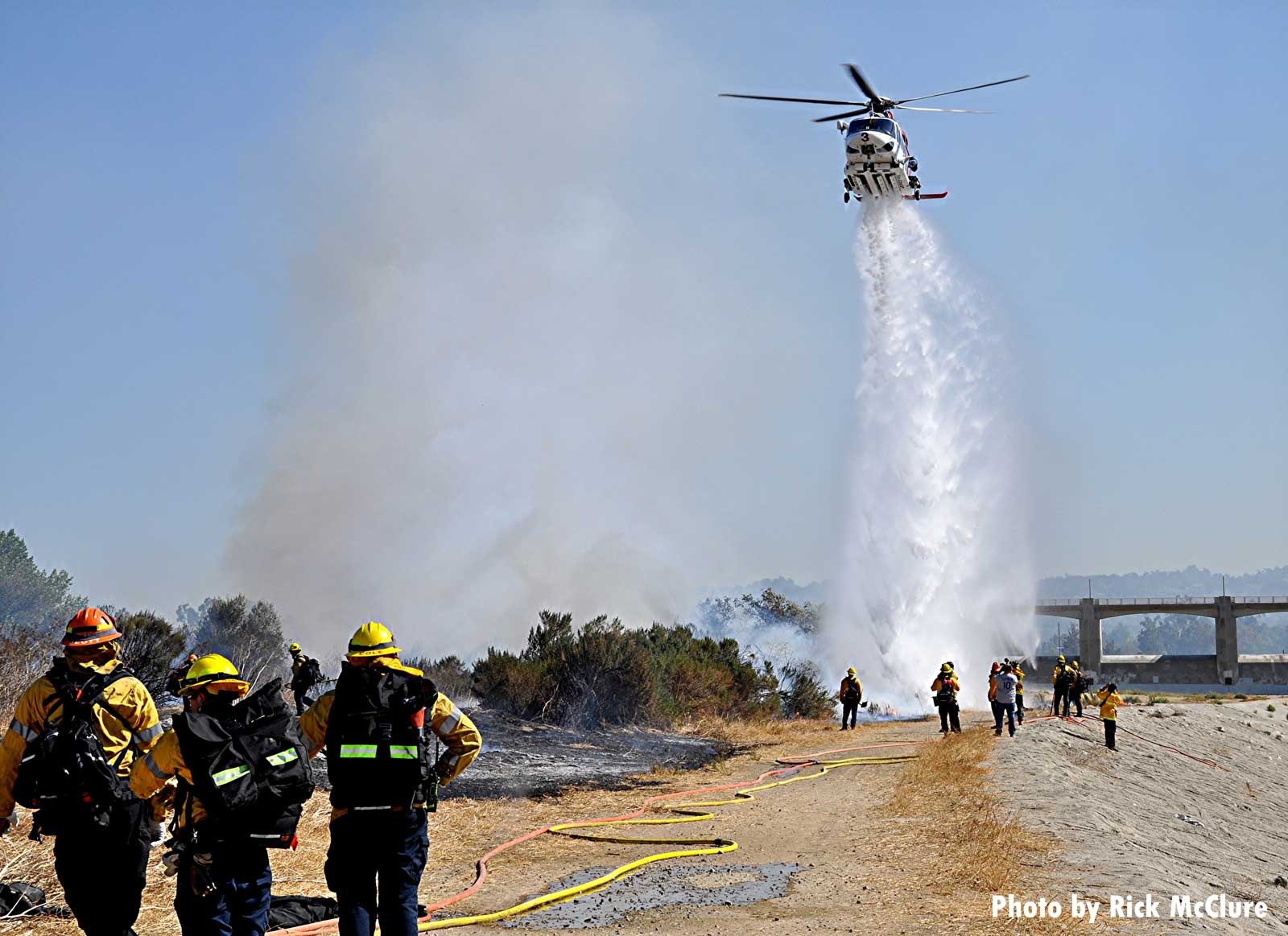 Helicopter drop on vegetation fire in Los Angeles