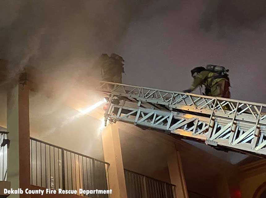 Firefighters on an aerial ladder at a hotel fire