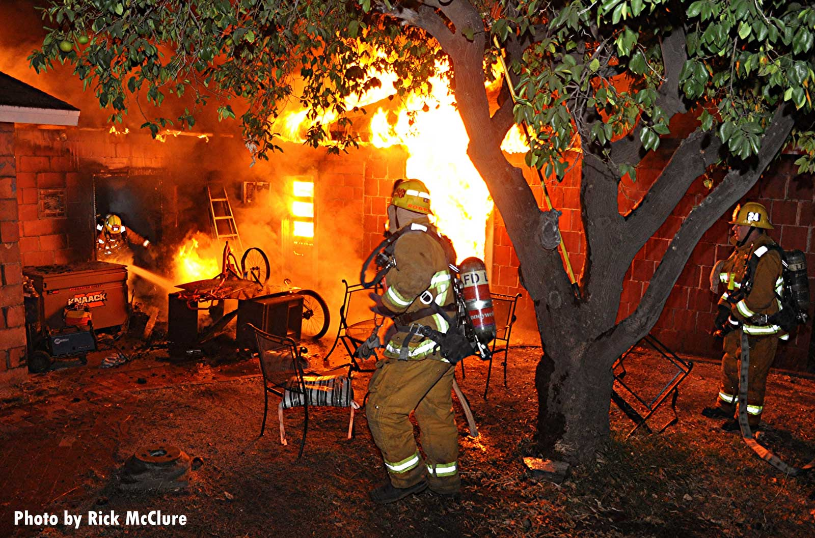 A firefighter framed by flames in Los Angeles