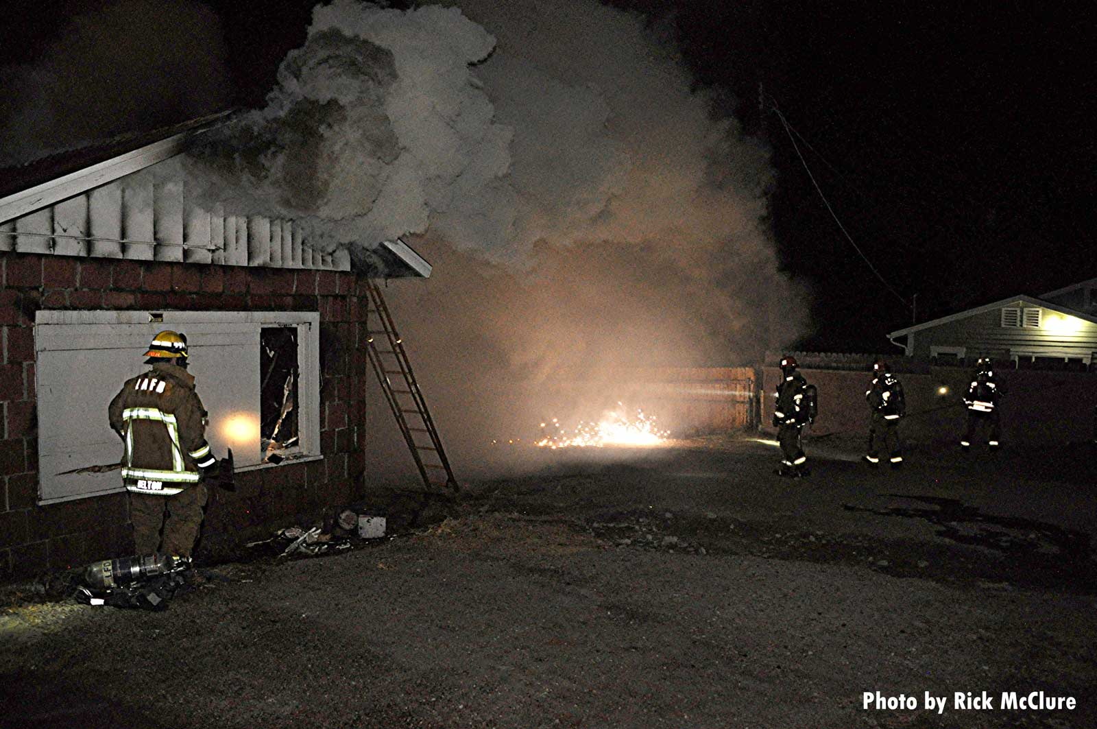 Firefighters confront down power lines at house fire