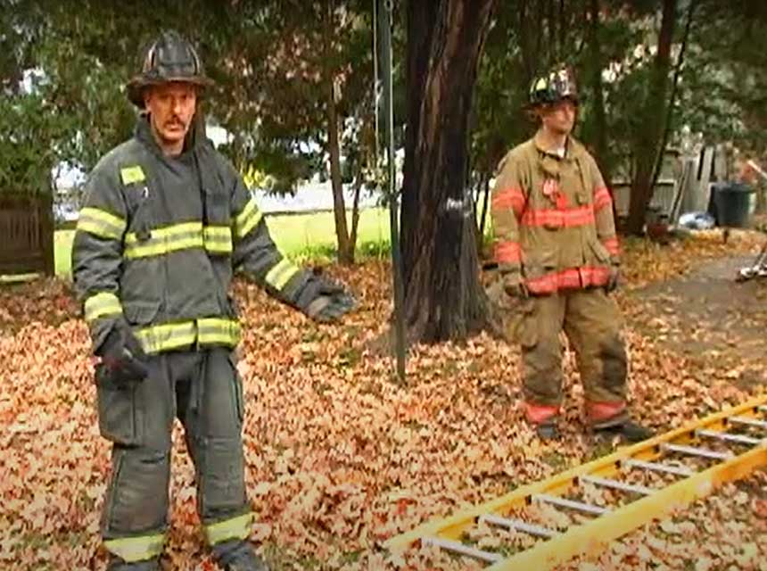 Mike Ciampo and another firefighter with a ground ladder