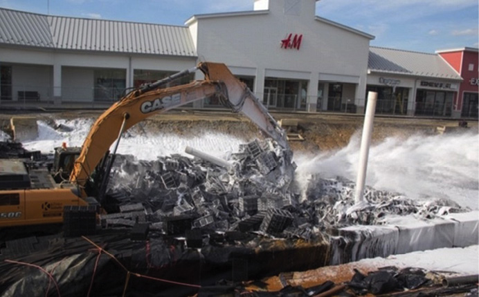 Track hoe operations that broke up drainage system components during foam application.
