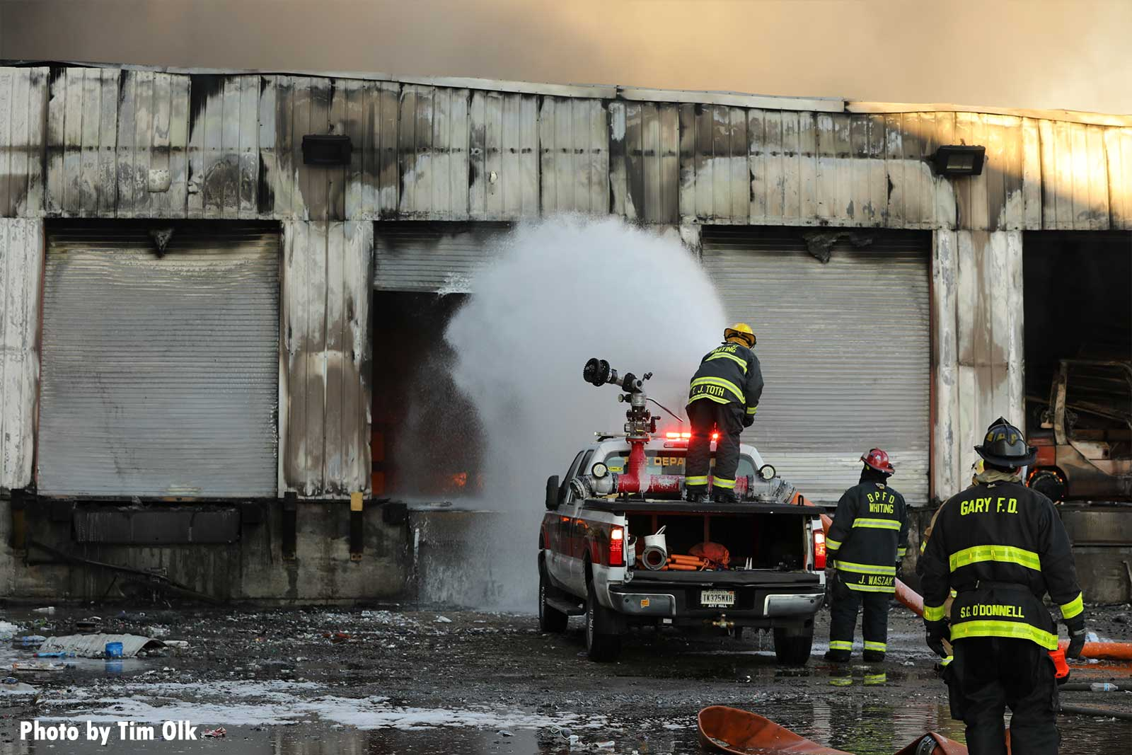 Firefighter uses cannon to blast foam into building