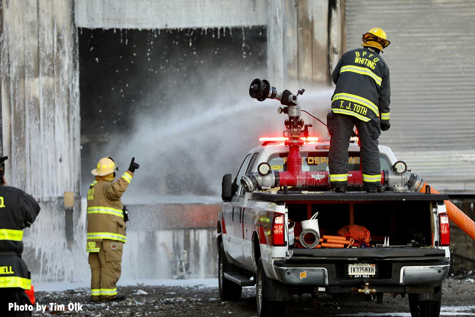 Truck-mounted foam cannon being used on fire