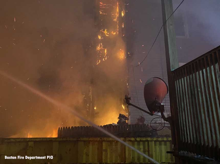 Fire at a three-alarm fire in the Dorchester section of Boston, Massachusetts