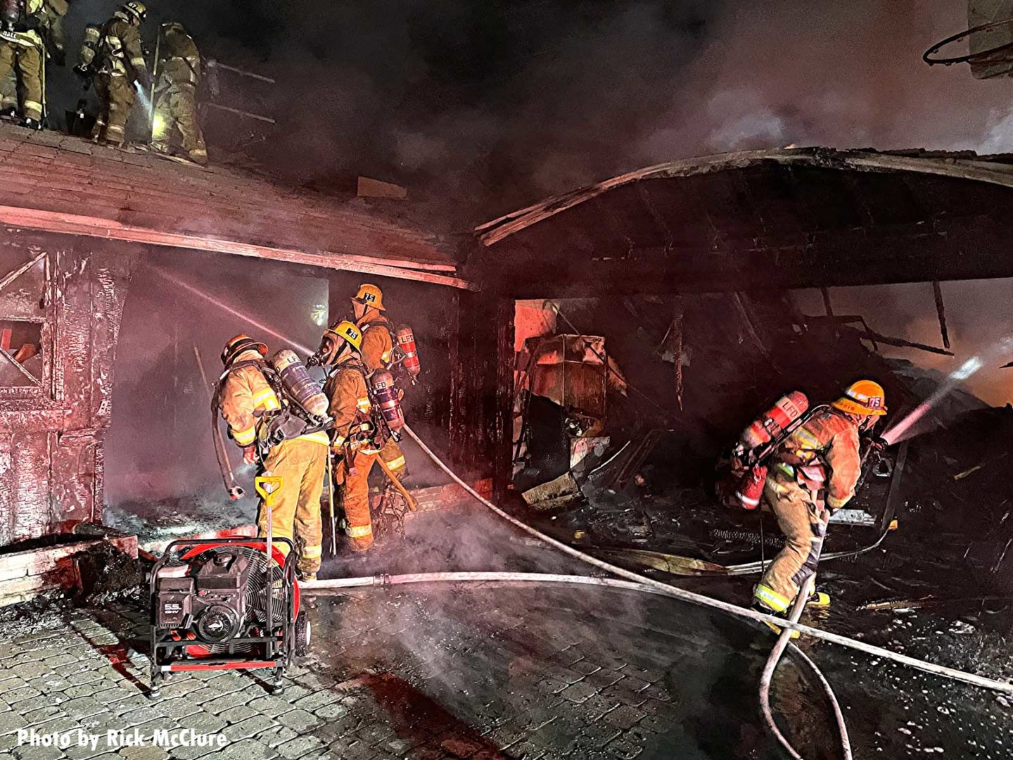 Firefighters with two hoselines at fire in Granada Hills