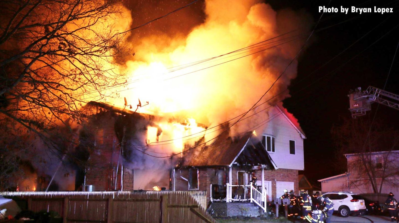 Massive flames burn a home on Long Island, New York