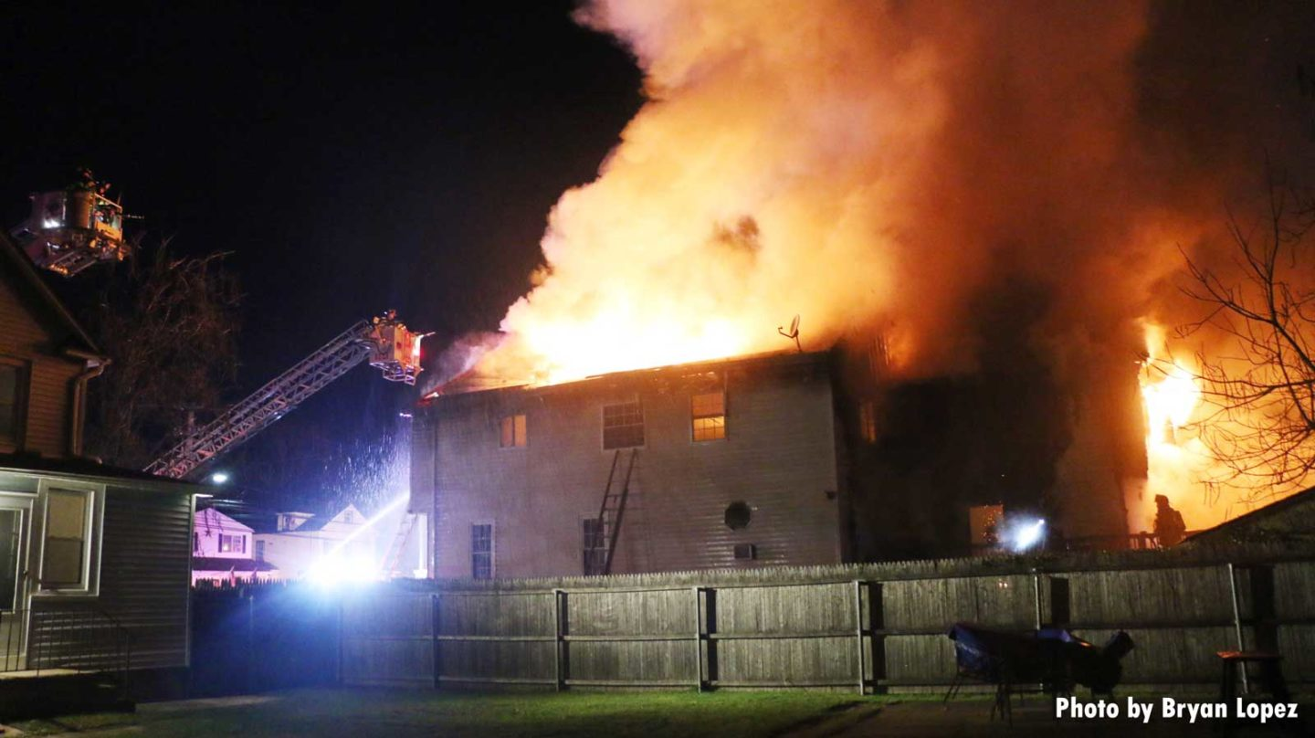 Another view of the fire with tower ladders working