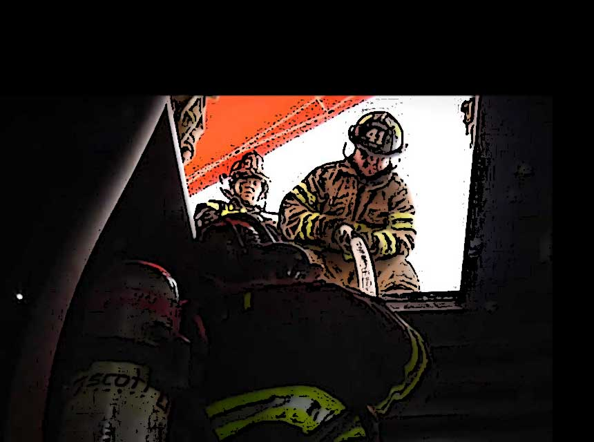 Firefighters pull a down firefighter through the floor using a hoseline