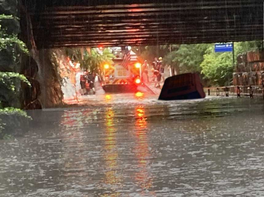 Vehicle submerged in underpass