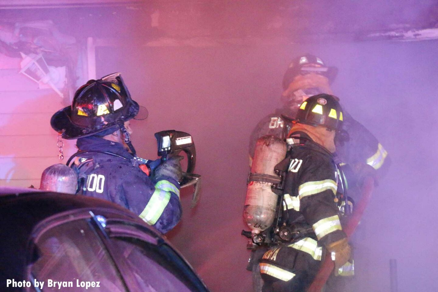 Firefighters using equipment at Brentwood fire