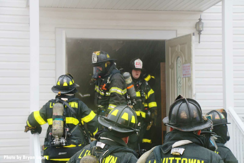Firefighters congregate at door of church