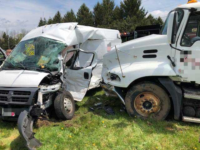 Truck versus delivery van crash