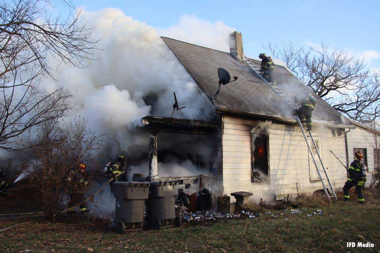 Indianapolis firefighters work to control a residential structure fire on Christmas Day 2020.