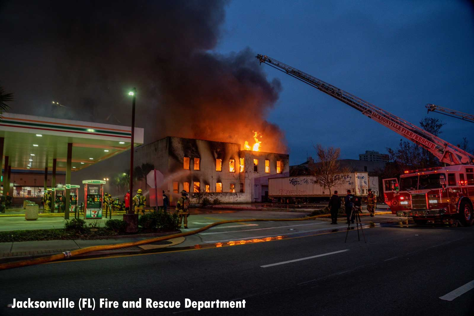 Flames shooting from a commercial building in Jacksonville as firefighters raised aerial