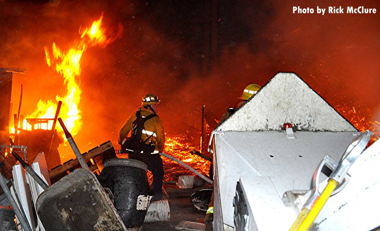 City of Los Angeles firefighter with a hoseline and flames