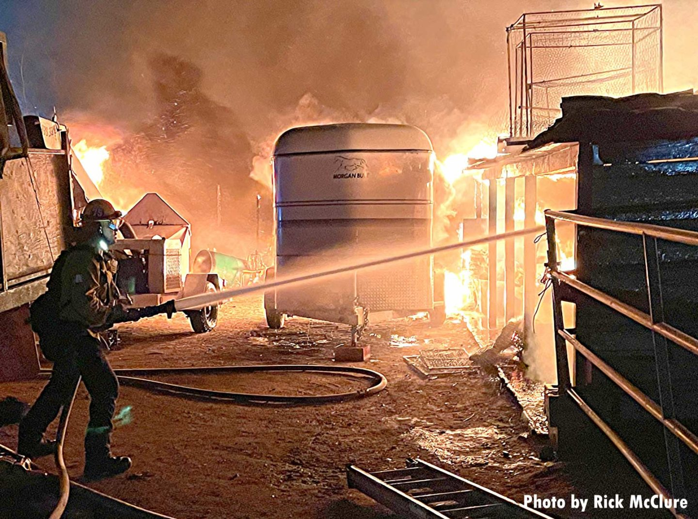 Firefighter trains a hoseline inside a structure
