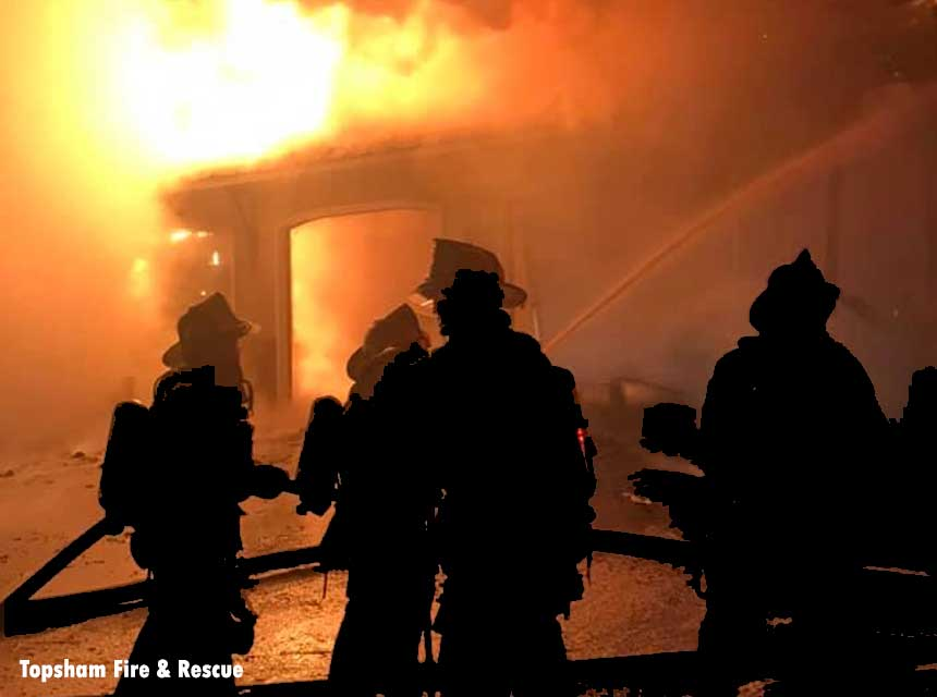 Firefighters at the scene of a raging fire in Lisbon, Maine.